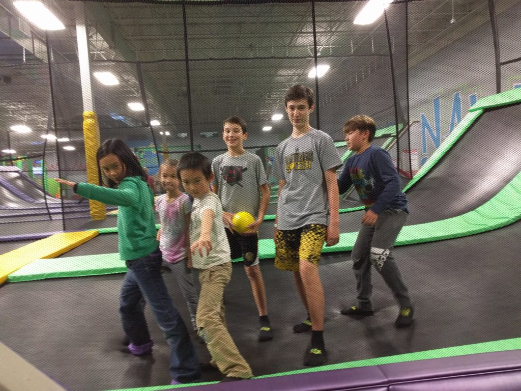 cousins hanging out at trampoline park